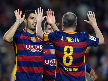 Barcelona's Uruguayan forward Luis Suarez (L) celebrates with Andres Iniesta after scoring during the match vs Real Sporting de Gijón. AFP