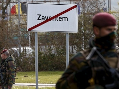 File photo of Belgian soldiers standing guard on a road leading to Zaventem airport. Reuters