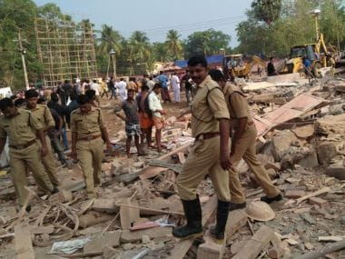 Police personnel at the site of the fire nishap in Kerala's Kollam. Image courtesy/Firstpost