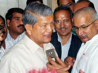 Deposed Chief Minister Harish Rawat being welcomed by Congress state president Kishore Upadhyay and other party MLAs during a meeting in Dehradun on Friday. PTI