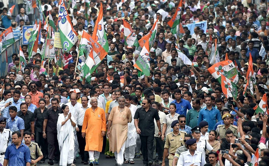 West Bengal Chief Minister and TMC Supremo Mamata Banerjee with party leaders and supporters at an election campaign rally in support of party candidates in Kolkata on Thursday. PTI