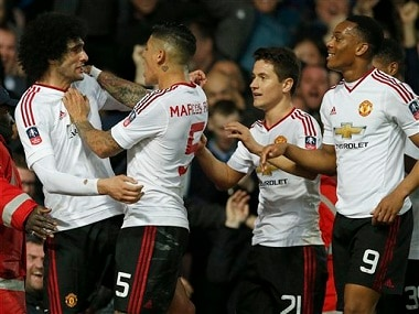 Manchester United players celebrate after a goal. AP