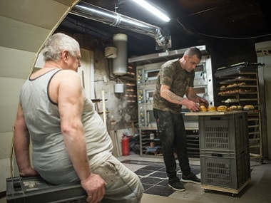 Michel Flamant (left) and Jerome Aucant work in their bakery. AFP