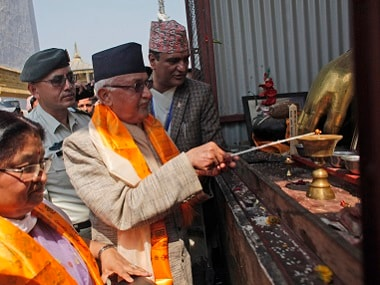 Nepalese Prime Minister Khadga Prasad Oli, center, lights a lamp to initiate reconstruction work in Swayambhunath stupa that was destroyed in last years's earthquake in Kathmandu. AP