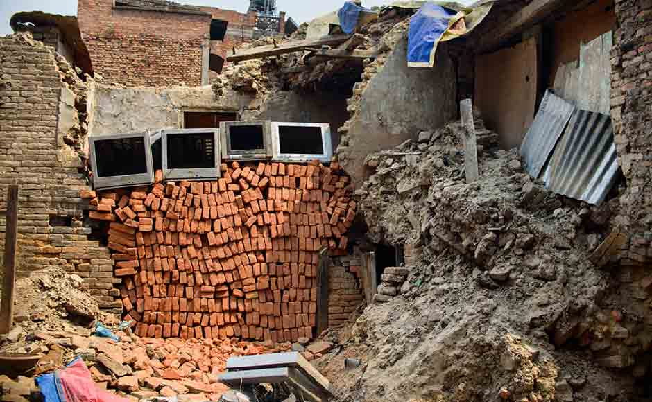 Locals put loose brick to cover their houses as cost of building material has jumped up. Image courtesy: Smita Sharma