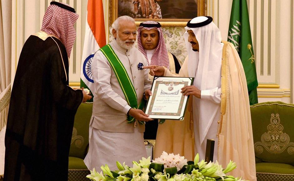 PM Narendra Modi being ordained the highest civilian award of Saudi Arabia, The Order of Abdullah in Riyadh. PTI