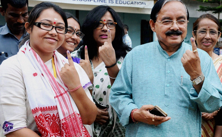 APCC President Anjan Dutta with his daughter and Congress candidate Angkita Dutta and other family members after casting their votes in Amguri on Monday. PTI