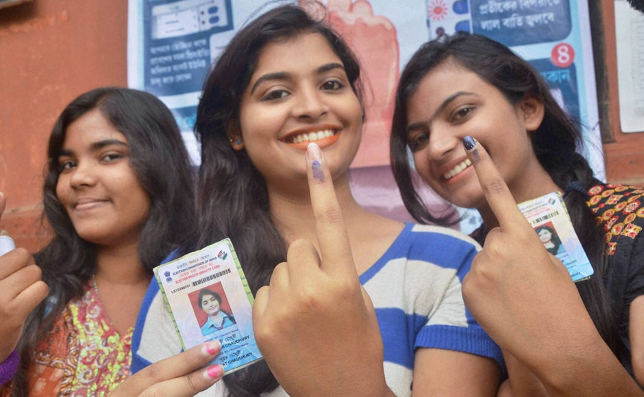 Voters in Silchar show their inked fingers after casting vote on Monday. PTI