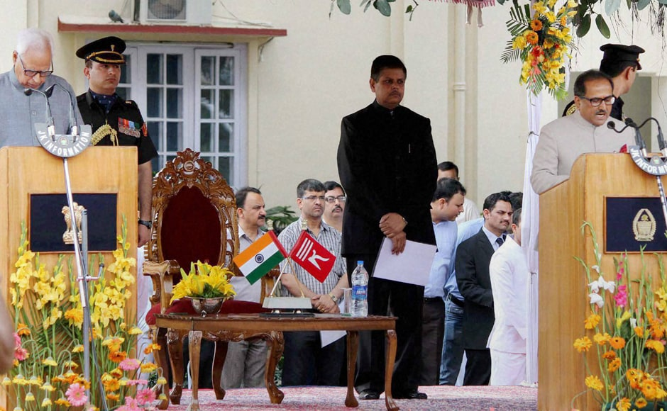 Jammu and Kashmir Governor N N Vohra administering oath of office to J&K Deputy Chief Minister Nirmal Singh at Raj Bhawan in Jammu on Monday. PTI