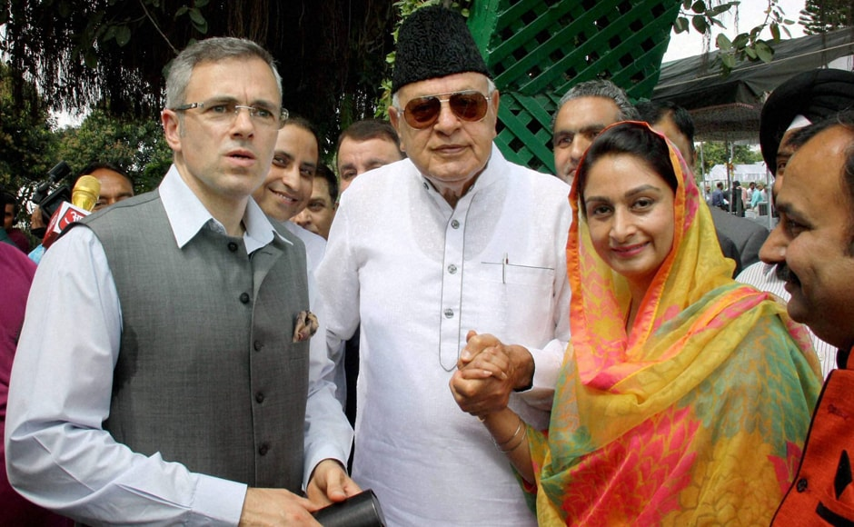 Union Minister Harsimrat Kaur Badal with former Union Minister Farooq Abdullah and former J&K chief minister Omar Abdullah during oath taking ceremony of new J&K Chief Minister Mehbooba Mufti at Raj Bhawan in Jammu. PTI