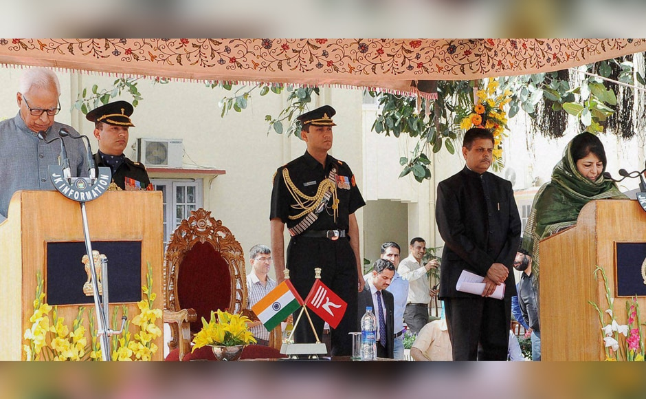Jammu and Kashmir Governor N N Vohra administering oath of office to J&K Chief Minister Mehbooba Mufti at Raj Bhawan in Jammu on Monday. PTI