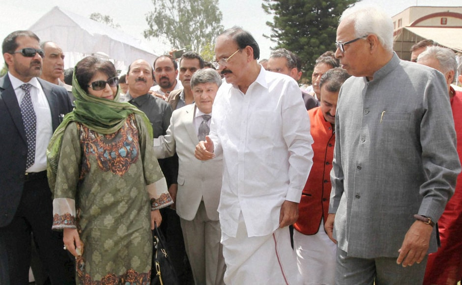 New J&K Chief Minister Mehbooba Mufti with Union Parliamentary Affairs Minister Venkaiah Naidu and J&K Governor NN Vohra during oath taking ceremony at Raj Bhawan in Jammu. PTI
