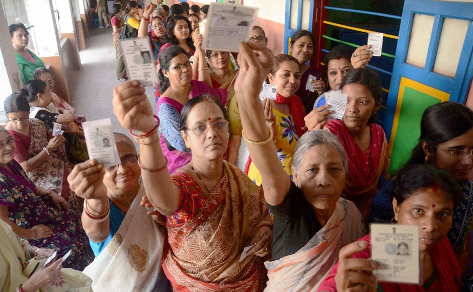 Women showing their voter cards during the first phase of the West Bengal Assembly Elections in West Medinipur on Monday. PTI