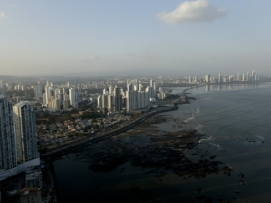 """The setting sun lights up the Panama City skyline, Monday, April 4, 2016. Panama's President  Juan Carlos Varelasays says his government will cooperate """"vigorously"""" with any judicial investigation arising from the leak of a vast trove of information on the offshore financial dealings of the world's rich and famous. An international coalition of media outlets Sunday published investigations it said stemmed from the leak of 115 million records kept by the Panama-based law firm Mossack Fonseca on behalf of clients. (AP Photo/Arnulfo Franco)"""