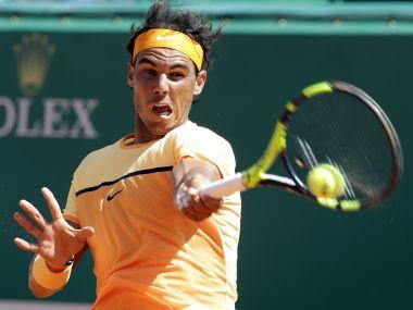 Rafael Nadal plays a return to Stanislas Wawrinka during their quarterfinal match at Monte Carlo. AP