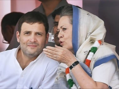 Congress President Sonia Gandhi talks to party Vice President Rahul Gandhi on stage during the farmers rally at Ramlila Maidan in New Delhi on Sunday. PTI Photo by Shahbaz Khan(PTI4_19_2015_000049B)