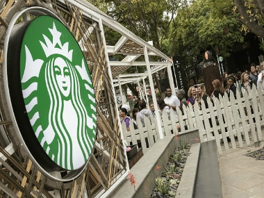 Hundreds of people queue during the official opening of South Africa's first Starbucks store, also the US coffeehouse chain's first store in Sub-Saharan Africa. Getty Images