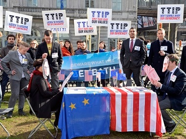 Activists stage mock talks as they demonstrate against the Transatlantic Trade and Investment Partnership (TTIP) outside the European Parliament at Luxembourg Place in Brussels. File photo AFP