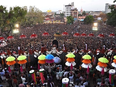 File photo of thousands of Pooram fans watching the processions led by caparisoned elephants in Thrissur in Kerala. AFP