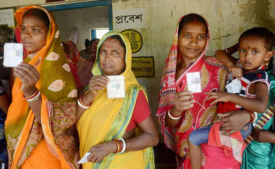 Women show their voter cards before casting votes at a polling booth during the state assembly elections in Kharagpur, West Bengal on Monday. PTI
