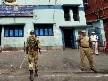 Security personnel stand in front of a polling station during the 3rd phase of assembly elections in Kolkata on Thursday. PTI