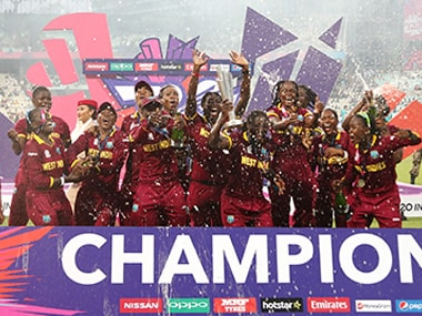 West Indies women's team with the World T20 trophy at Eden Gardens on Sunday. AP