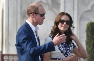 Are they talking about the Taj Mahal? Britain's Prince William, along with his wife, Kate, the Duchess of Cambridge at the Taj Mahal in Agra on Saturday. PTI<br />