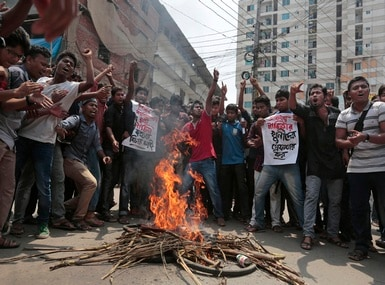 Bangladeshi students protest the killing of activist Nazimuddin Samad. Islamist groups have been involved in a spate of attacks on secularists in Bangladesh. AP