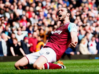 Andy Carroll struck an 8-minute hat-trick to dent Arsenal's title hopes. Getty
