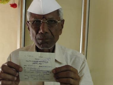 Farmer Ram Venkat Rao Hande with his insurance payment receipt
