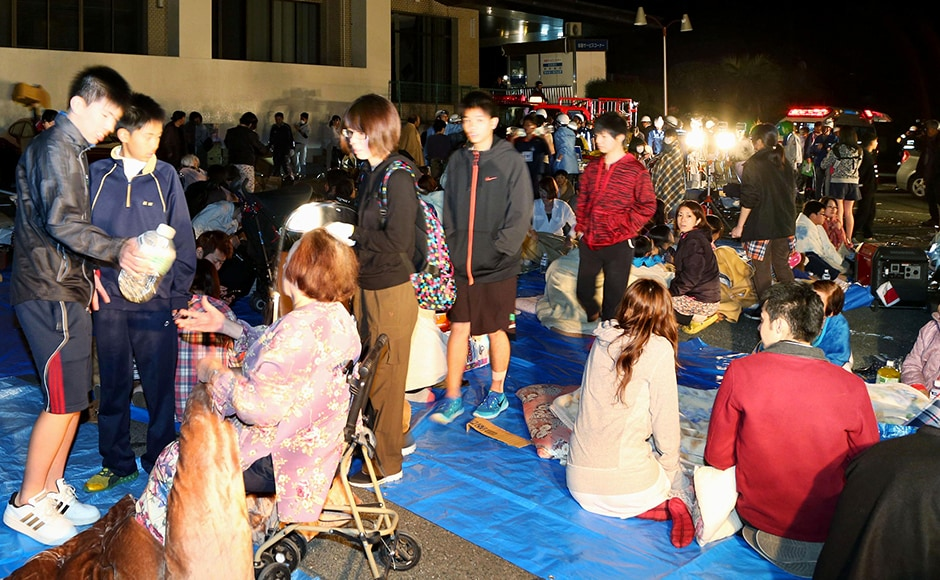Stranded people gather outside a town hall of Mashiki, after the earthquake. Japanese broadcaster NHK showed Mashiki town hall in the dark, apparently having lost power. Footage also showed rubble on the road, shards of glasses and broken windows, and fire breaking out in some places, with firefighters battling an orange blaze. AP