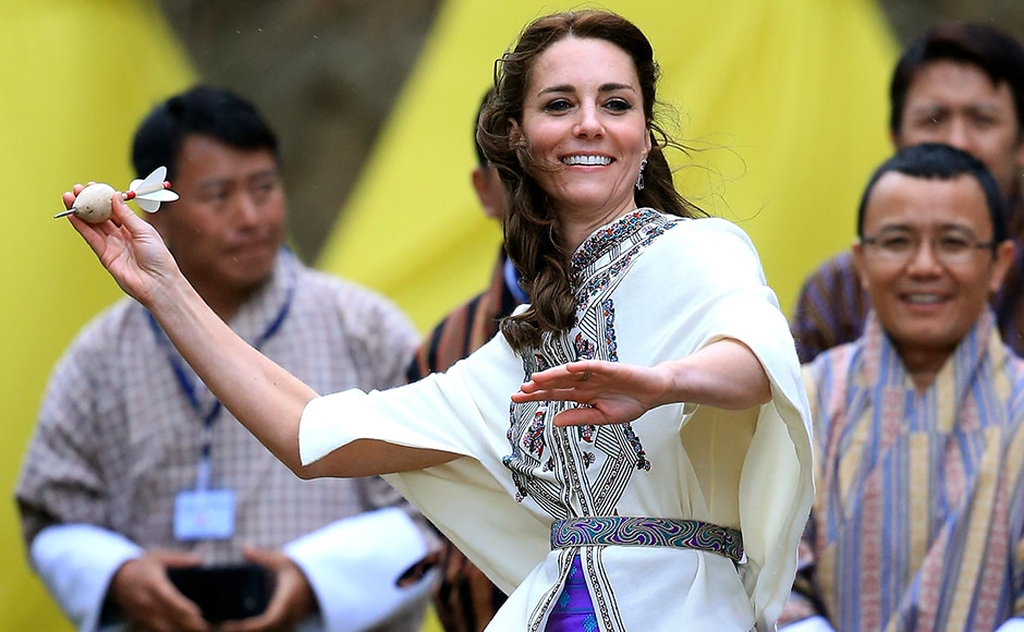 Catherine, Duchess of Cambridge throws a dart during a Bhutanese sporting demonstration on the first day of a two day visit to Bhutan. Getty