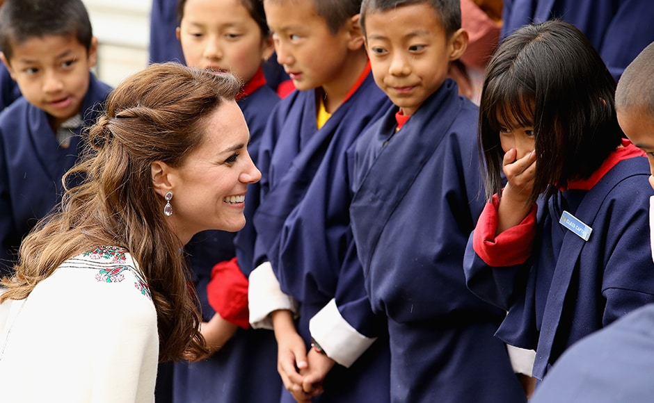 Catherine, Duchess of Cambridge meets children before a Bhutanese archery demonstration on the first day of a two day visit to Bhutan. Getty