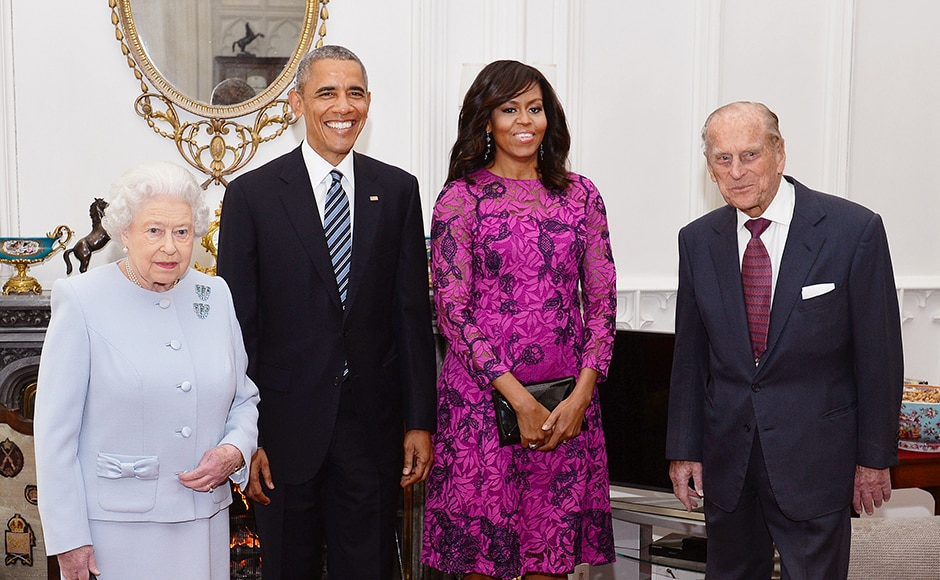 Britain's Queen Elizabeth II and the Duke of Edinburgh stand with the President and First Lady of the United States Barack Obama and his wife Michelle, in the Oak Room at Windsor Castle ahead of a private lunch hosted by the Queen in Windsor, Britain. Reuters