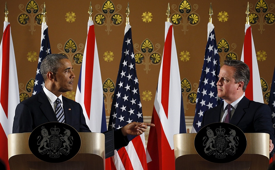 US President Barack Obama points towards British Prime Minister David Cameron during a news conference following their meeting at 10 Downing Street in London. Reuters