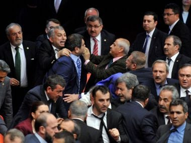 Turkish lawmakers argue and push each other on the Assembly floor in Ankara. AP