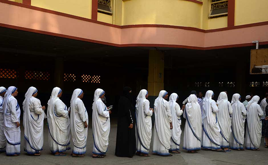 "<span style=""font-size: 16px; line-height: 1.5;"">Nuns from the Missionaries of Charity wait in a queue to cast their votes inside a polling station in Kolkata on Thursday. Assembly elections in West Bengal are taking place in six phases from 4 April to 5 May. AFP</span>"
