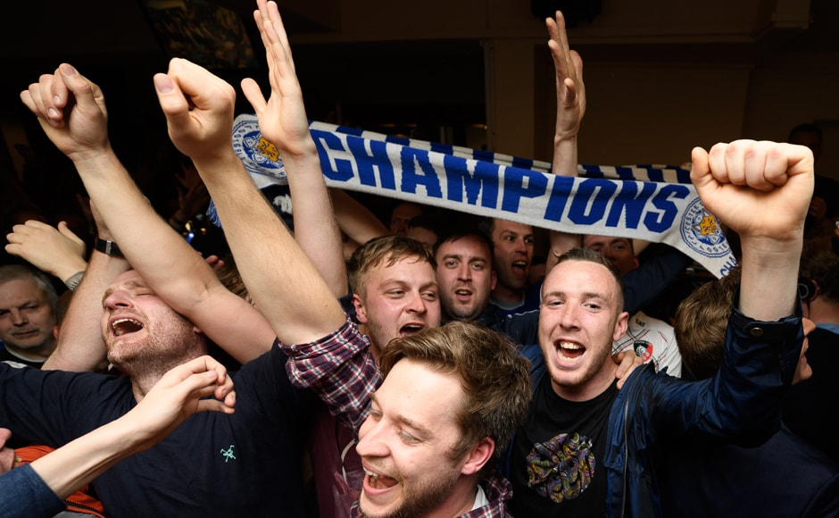 Champions! Leicester City fans celebrate their team's Premier League triumph in central Leicester. This is LCFC's first ever English title. AFP