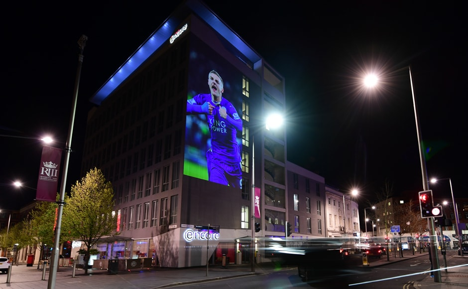 A large projection of an image of Leicester City's striker Jamie Vardy is seen on the side of a building as the city celebrate's their team becoming the English Premier League champions. AFP