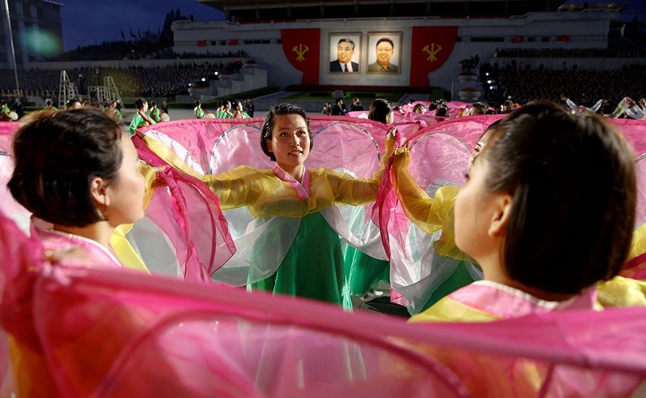 People participate in a mass dance in the capital's main ceremonial square. Reuters
