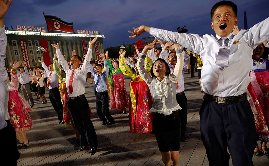 People participate in a mass dance in the capital's main ceremonial square, a day after the ruling Workers' Party of Korea party wrapped up its first congress in 36 years. Reuters