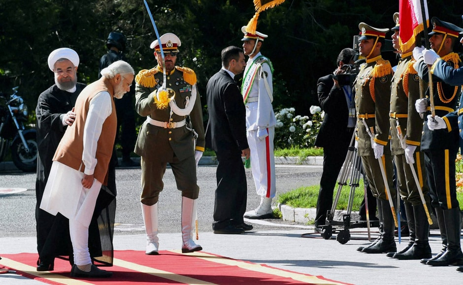 PM Narendra Modi reviews an honor guards as he is welcomed by Iranian President Hassan Rouhani, during an official arrival ceremony at the Saadabad Palace in Tehran. PTI