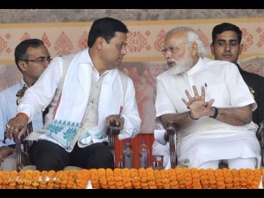 Prime Minister Narendra Modi with the newly sworn-in Assam Chief Minister Sarbananda Sonowal on Tuesday. PTI