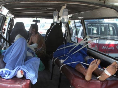 Injured Afghan men lie in an ambulance after an accident on the main highway linking the capital, Kabul, to the southern city of Kandahar, in Ghazni province eastern of Kabul, Afghanistan, Sunday. AP