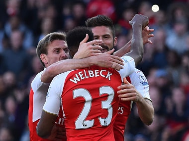 Arsenal players celebrate after scoring against Norwich in the Premier League. AFP