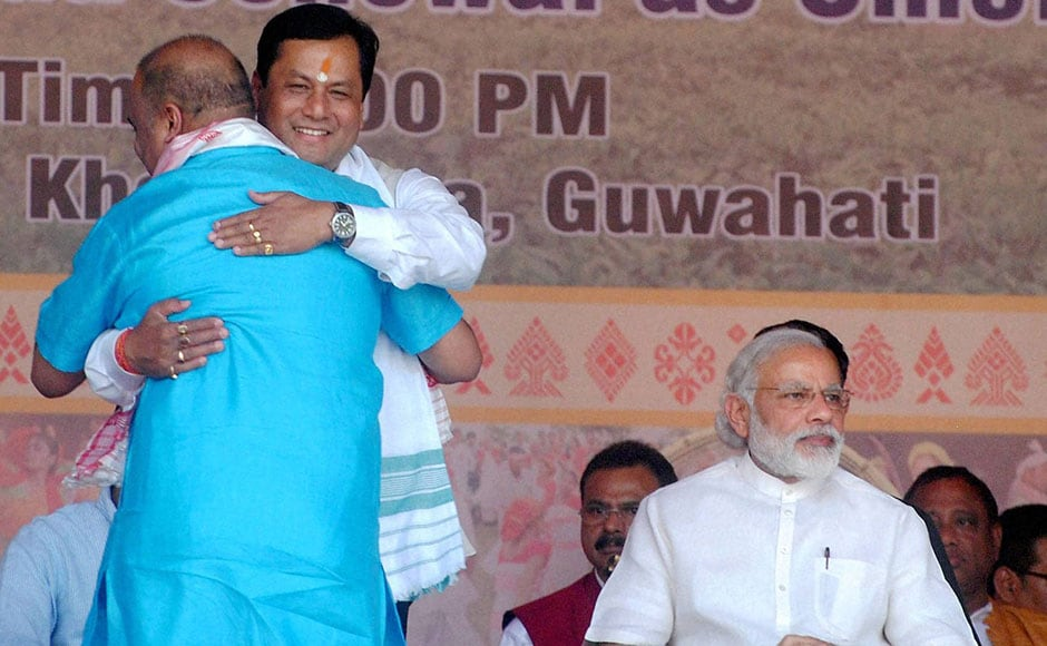 Newly sworn-in minister Himanta Biswas Sarma greets Chief Minister Sonowal. Sonowal, who belongs to the Sonowal-Kachari tribe, has contested this assembly polls from Majuli, the world's largest river island and the seat of Vaishnavite culture. PTI