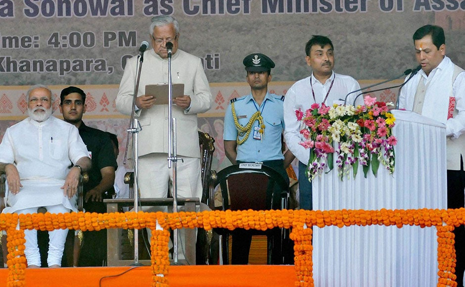 Assam Governor PB Acharya administers the oath to Sarbananda Sonowal as Chief Minister of Assam in presence of Prime Minister Narendra Modi in Guwahati on Tuesday. PTI
