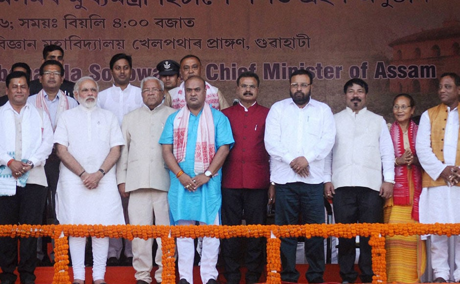 The newly sworn-in Assam Chief Minister Sarbananda Sonowal along with his 14 cabinet ministers after the swearing-in ceremony in Guwahati on Tuesday. PTI