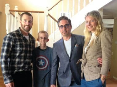 Ryan Wilcox with Chris Evans, Robert Downey Jr, and Gwyneth Paltrow. AP