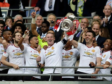 Manchester United's Wayne Rooney lifts the FA Cup trophy at Wembley. AP